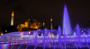 A slow shutter capture of the fountain in Sultanahmet Square with Hagia Sophia in the background.