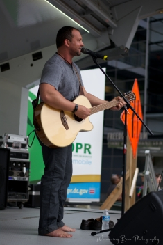 Justin Utley performs on the Capital Pride Dupont stage barefoot.